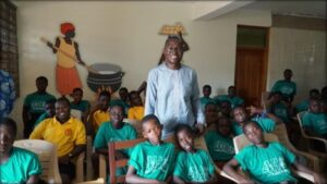 Dr. Alex Yahw Adom surrounded by students